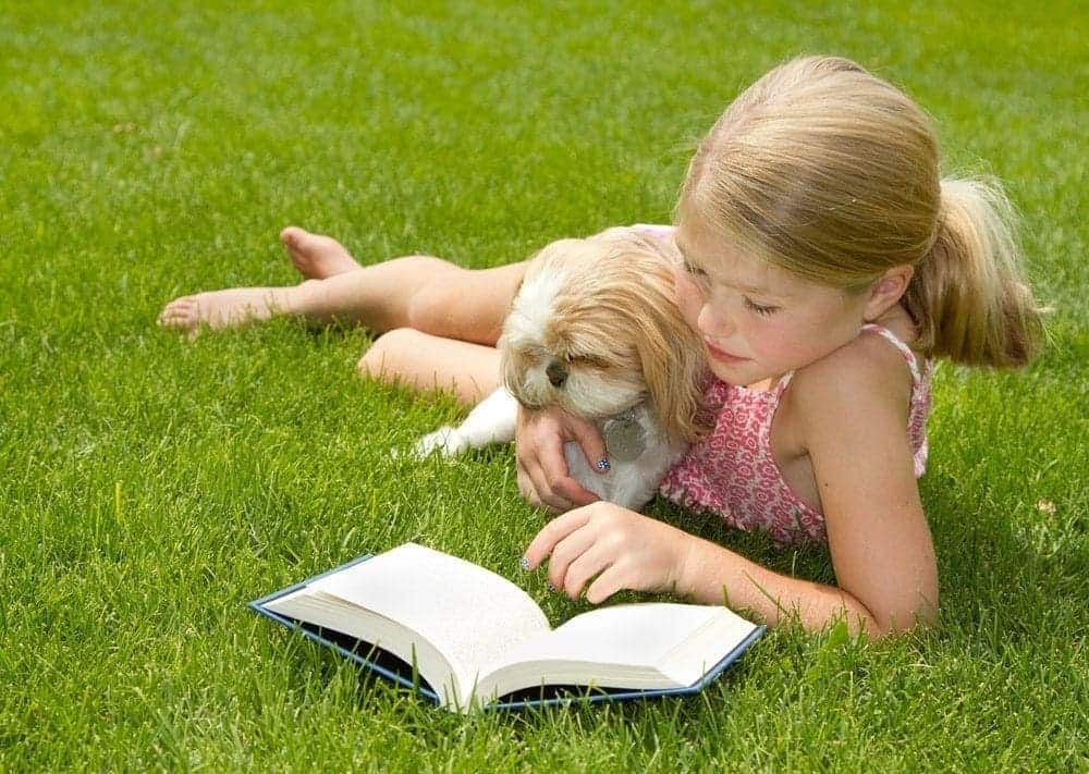 kids reading to the dog